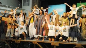 Cast members rehearse a scene in Act I of Joseph and The Amazing Technicolor Dreamcoat.