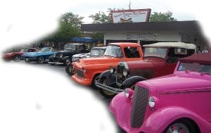 Classic cars line up outside the Hot Dog Stand Monday morning in Grand Blanc. The cars will be part of the upcoming Back to the Bricks event taking place across Genesee County starting Friday in Davison.