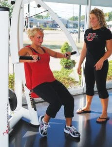 Nicole Lintz of Grand Blanc works out with personal trainer Berlin Heusted of Flushing at UltiFit, G-4164 Miller Rd. UltiFit, which opened a month ago, is a results-oriented fitness facility offering 24-hour access, locker rooms, showers and a full, free weight section.