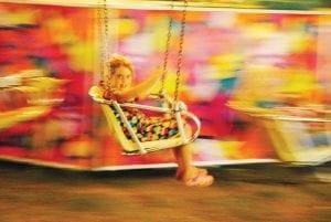 SWING TIME — Alaina Welch of Burton takes a ride on Yo-Yo.