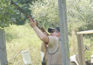 Troop 340 scout master John Grzecki of Goodrich takes aim.