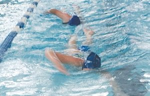 Carman-Ainsworth swimmers are learning the strokes under a new coach this year.