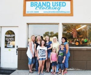 WELCOME — Manager Tracy Bost, from left, Hailie Bost, Alisha Bost, Tabitha Klenk, Mackenzie Edge, owner Christy Klenk, Hunter Edge and employee Elizabeth Barker welcome shoppers to Brand Used Clothing, 8048 Miller Rd., Suite D.