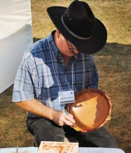 The Creative Touch artist Darrel Frederick of Owosso paints one of his hand carved wooden bowls.