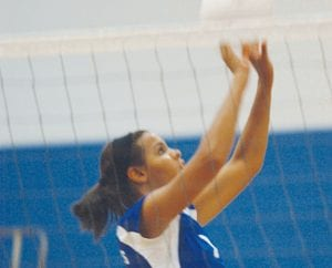Kamrin Gold sets the ball for Carman-Ainsworth against Lapeer West.