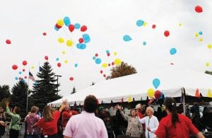 UP, UP AND AWAY — Attendees at the 21st Annual Fall Fest at Woodhaven Senior Community celebrated the Sept. 11 event with a balloon launch. See the story on page 4.