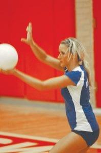 Carman-Ainsworth's Kylie Schneider on serve.
