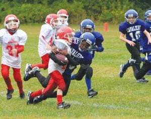 Youth football season off and running The Mid Michigan Rural Football League saw Carman-Ainsworth take on Swartz Creek at Carman- Ainsworth last Saturday. Carman's Dwayne Gurley was captured while on a breakaway run.
