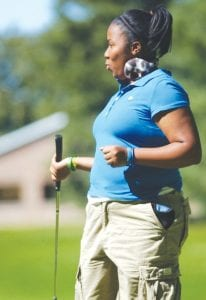 Tanara Crawford reacts to sinking a long putt.