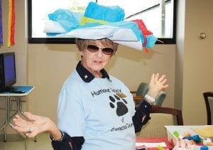 Volunteer Jeanne Aaronson of Flint shows off her one-of-a-kind hat during the Genesee County Humane Society's Simply Seniors event Sept. 24.