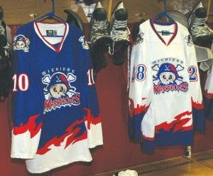 Home and away jerseys hang on display at Perani Arena for the new Michigan Warriors.