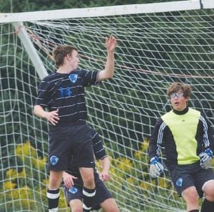 Alex Sarver heads the ball away from the goal in a game earlier this season.