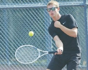 Carman-Ainsworth's Erick Skaff competes at No. 1 Singles.