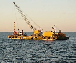 Crews work in Lake Huron to drill 14 test holes approximately 30 feet into the soil.