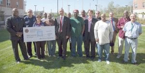 Members from General Motors' Veterans Affinity Group Customer Care and Aftersales Chapter present Piquette Square, 6221 Brush St., Detroit, with a $5,000 donation to help cover costs for the veterans living there.