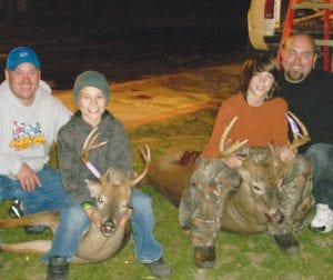 Todd Jarema posed with his son, Tyler, 13 at the Davison buck pole on Sept. 26. Jarema placed fifth with his 7-point. Kyle Rousseau, 13, posed with with his dad Shane and his first place 9-point out of Grand Blanc that weighed 202 pounds.