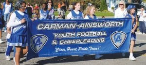 Members of Carman- Ainsworth Youth Football and Cheerleading showed their spirit during the parade.