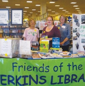 BOOK FAIR — Friends of the Perkins Library (FOPL) member Laurel Burns, left, President Rose Keen and member Pat Peterson helped raise money and books for the Perkins Library during the FOPL Book Fair at Barnes & Noble Oct. 9. The event featured story time by Miss Carol, a visit from Randy the Singing Cyclist and appearances by the Library Mouse, all to help FOPL.