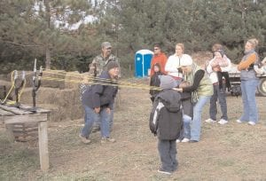 Families take turns with the pumpkin launcher at Pumpkins in the Pines.