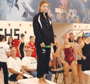 Carman-Ainsworth's Paige Conway, shown here at the Genesse County Meet at Fenton, finished second in the diving event against Flint Powers.