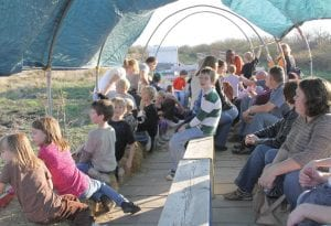 Families and friends (above) piled into the trailer for a hayride through Porter's farm and orchard to reach the pumpkin patch and corn maze. The fall events will run through Oct. 31.