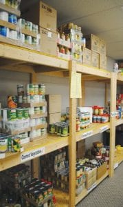 Shelves inside the pantry of the Swartz Creek Community Food Basket are stocked with a variety of items for local families.