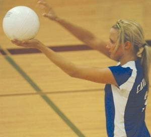 Carman-Ainsworth's Kylie Schneider on serve earlier this season.