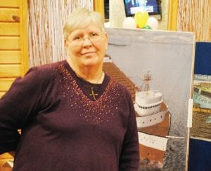 Pam Johnson, daughter of Chief Steward Robert Rafferty, stopped by BD's Mongolian BBQ Nov. 9 for a special event marking the 35th anniversary of the sinking of the Edmund Fitzgerald. Rafferty was one of the 29 crew members who lost their lives on the ship.