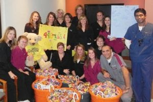 SWEET CASH — The Dental Care Team, G- 8189 S. Saginaw St., Grand Blanc, did a Halloween candy buy-back from area children for $2 per pound, giving $1 to the child and $1 to the Children's Miracle Network. All the candy collected goes over seas to U.S. troops. The children also made cards for the troops. This was the second year doing this event. Last year the Dental Care Team collected 300 ponds of candy and this year collected 446 pounds.