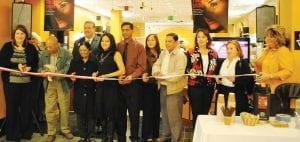 Himani and Deepak Gupta, center, owner of Himani Makeup & Skincare, cuts the ribbon at the store's official grand opening Nov. 12 in the Genesee Valley Center. Officials from Flint Township, the Genesee Valley Center, the Genesee Regional Chamber of Commerce and Grand Blanc Chamber of Commerce were on hand for the ceremony.