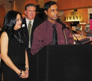 Himani and Deepak Gupta addressed the crowd during the store's grand opening.