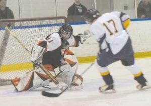 Flushing's Casey Bradshaw contended with West's Braydin Walters last Saturday at the Polar Palace.