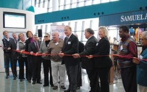 Officials from Bishop International Airport, Flint Township, the Genesee County Regional Chamber of Commerce and other local organizations cut the ribbon on the airport's new Airside Expansion.