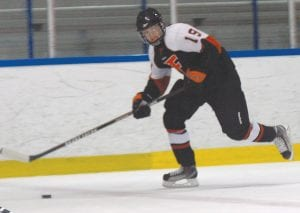 Flushing/Carman-Ainsworth's Drew Sanborn made his way down the ice on a breakaway.