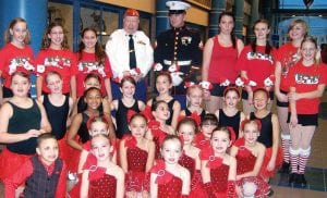 SMOOTH STEPPERS — (Back row, left, to front row) Alyssa Juratich, Jordan Taylor, Hailey York, Gary Stanley from Toys for Tots, Cpl. Herzog, U.S. Marine Corps. Reserves, Kennadi Wascher, Shelby Nemitz, Nicole Hakins, Sara DeDolph, Breanne Defoe, Selleka Fick, Aliyah Stanley, Braxton Pifer, Olivia Logsdon, Macey Lewis, Alasia Panek, Karson Washer, Leigha Forsyth, Sydney Magnity, Erica Gilbert Elliana Logsdon, Mackenzie Bauserman, Zoe Sutter, Charles Stanley, Melanie Fenoglio, Madison Janes, Abby Schell, Alexis Roshner and Rachel Kraysovic from Smooth Steps Dance and Gymnastics performed at the 3rd Annual Winter Fest at Carman- Ainsworth High School. See page 4 for more details.