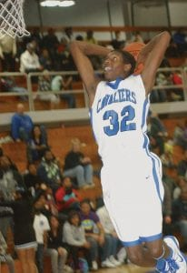 Anton Wilson goes up for a two-handed slam dunk in the second half against Clarkston.