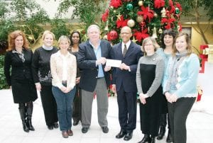 Members of the HealthPlus staff recently donated $4,000 they raised to the Food Bank of Eastern Michigan.