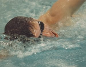 Erick Skaff strokes through part of his 10-mile swim on Dec. 30 to raise awareness of the shortage of clean water around the world and to benefit those without it. The Carman- Ainsworth senior raised a total of $14,195.