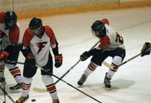 Flushing's Kevin Wilson (No. 25) battles for the puck at the feet of his teammates last Wednesday when the squad played visiting Goodrich.