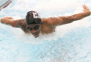 Carman-Ainsworth's Jarron McAllister broke the water's surface during his leg of the butterfly event at a recent swim meet.