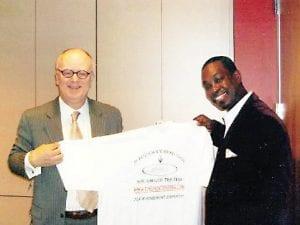 Marcus Sharp with nxtArrow President John Howe.