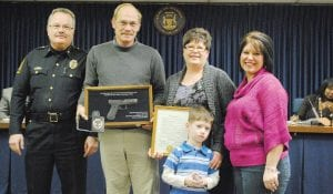 — Sgt. David Stone, second from left, was honored for his 25 years of service as a police officer for the Flint Township Police Department at the township's Jan. 10 meeting. Stone was joined by Chief of Police George Sippert, his wife Sheila, his daughter Amanda Wedding and grandson Dominick Wedding.