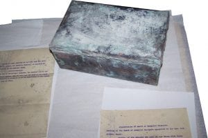 One of the copper boxes that were found sealed in the original cornerstones from Hurley Hospital.