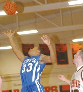 Gerald Holmes skies for a rebound in last Friday's game at Flushing.