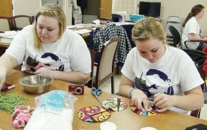 "Volunteers performed various deeds at the Genesee County Humane Society in honor of its ""Give a Day, Make a Difference"" event held on Martin Luther King, Jr. Day."