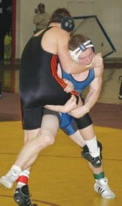 Carman-Ainsworth's Brett Dortch worked to take a leg out from his Flushing opponent.