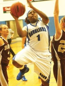 — Jasmine Boyd drives to the basket for two of her 21 points in Carman-Ainsworth's 68-50 win over Davison last Friday. Boyd also had 12 rebounds as the Lady Cavaliers jumped back into the Big Nine Conference race.