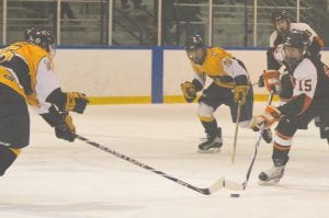 Flushing's Mickey Montpas rushed the puck against Goodrich at the Polar Palace in Lapeer last Saturday.