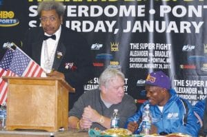 Promoter Don KIng prepares to address the media at the post-fight press conference along side copromoter Gary Shaw and main event winner Tim Bradley.