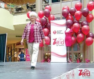 Maxine Sissons of Swartz Creek, a heart attack survivor, modeled four outfits in the Go Red for Women fashion show.